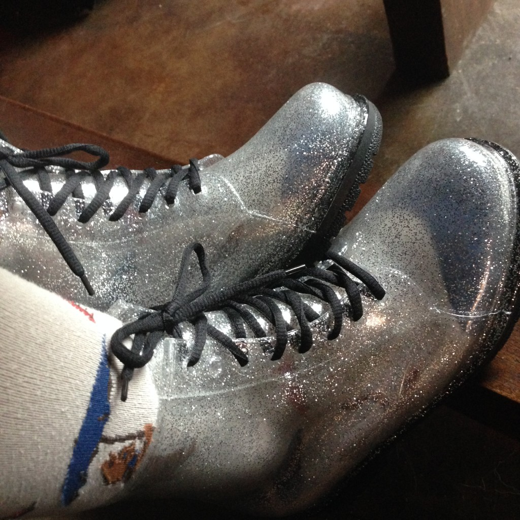 like combat boots, but fairly translucent, with a lot of silver glitter
